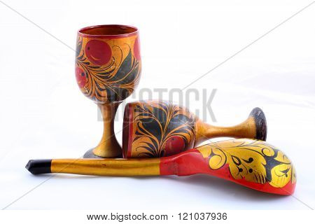 Wooden dishes, painted with floral ornament in the style of Khokhloma Russian