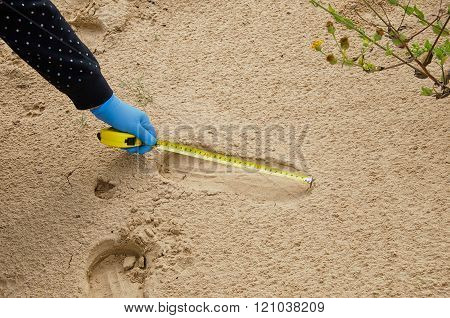 Forensic Expert Is Measuring The Shoe Print Length