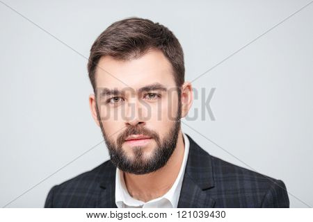 Serious businessman looking at camera isolated on a white background