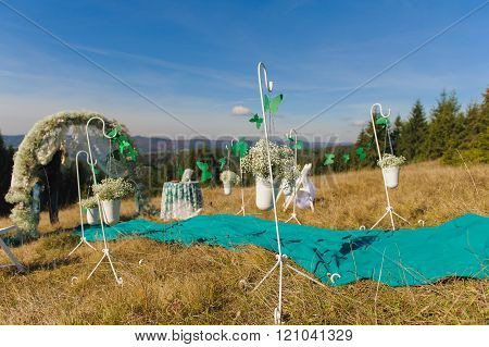 Outdoor wedding ceremony scene on a mountain slope