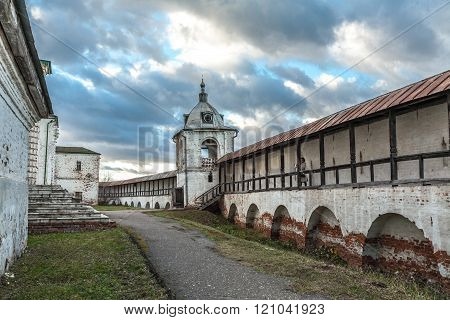 Pereslavl-Zalessky, Russia - November 03, 2015: Goritsky Monastery of Dormition, it was based in the first half of the XIV century at Ivan Kalita. The tourist on a monastic wall.