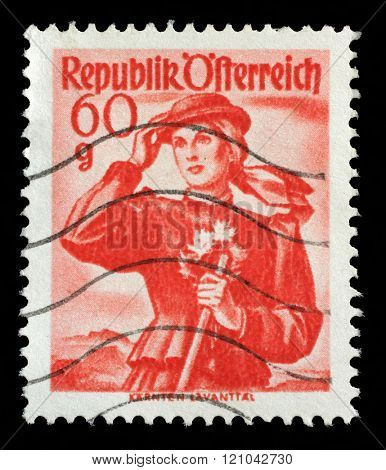 ZAGREB, CROATIA, SEPTEMBER 13: A stamp printed in Austria shows image woman in national Austrian costumes, Carinthia, Lavant Valley, series, circa 1948, in Zagreb, Croatia on September 13, 2014.