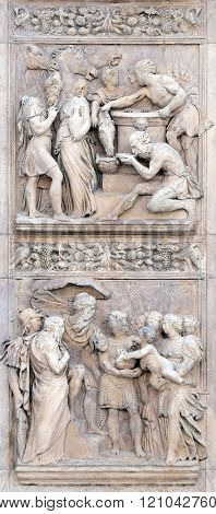 BOLOGNA, ITALY - JUNE 04: Stories of Rebecca up and Moses by Alfonso Lombardi, left door of San Petronio Basilica in Bologna, Italy, on June 04, 2015