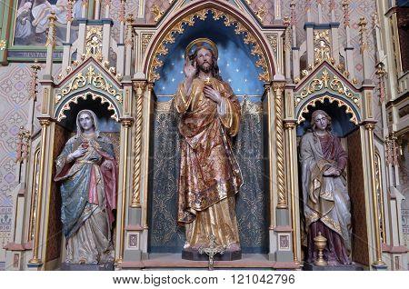 STITAR, CROATIA - AUGUST 27: Altar of the Sacred Heart of Jesus in the church of Saint Matthew in Stitar, Croatia on August 27, 2015