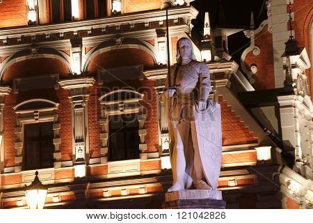 Sculpture Of Roland In Front Of House Of Blackheads. Night. Riga, Latvia