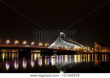 Riga - Latvia, March 6, 2016:  Night scene of the bridge and the National Library of Riga.