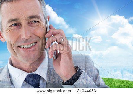 Buisnessman taking on mobile phone against new york