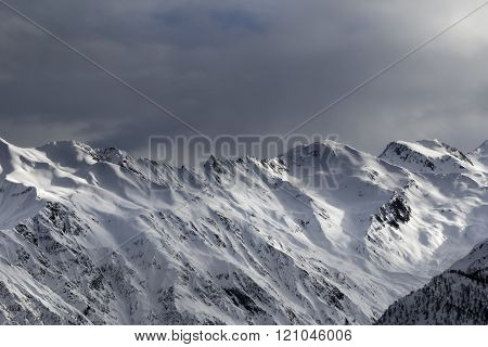 High Snowy Mountains And Sunlight Storm Sky In Evening