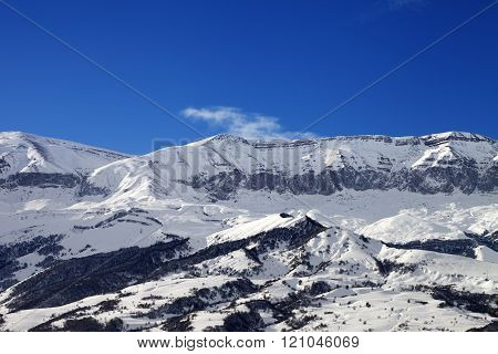 Snowy Mountains And Blue Sky At Nice Sun Day