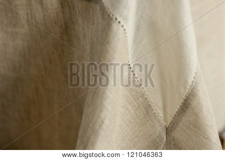 Close-up Of Tablecloth With Focus On Seams