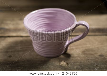 Purple Teacup On A Wooden Surface