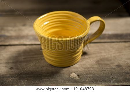 Yellow Teacup On A Wooden Surface