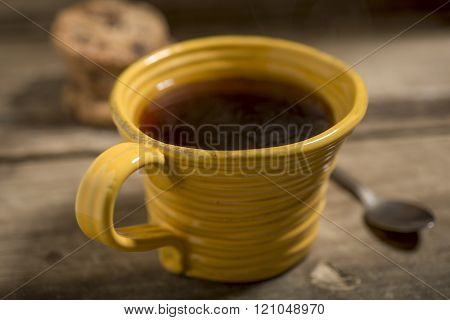 Yellow Cup Containing Warm Coffee Or Tea