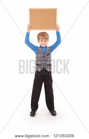 Boy Holding A Board Made Of Cork