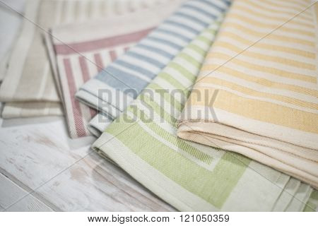 Close Up Of Colorful Folded Table Napkins With Woven Stripes