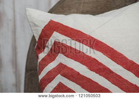 Close Up Of Corner Of Pillow With Red Zigzags