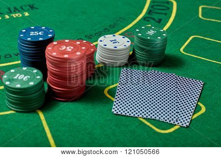 Casino chips and cards on casino table, poker game concept