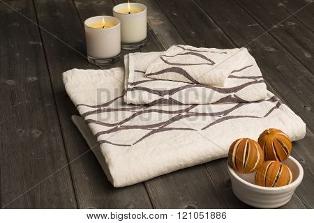 Stack Of Three Towels With Brown Concave Line Design