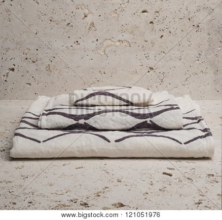 Pile Of Three White Towels With Brown Concave Lines