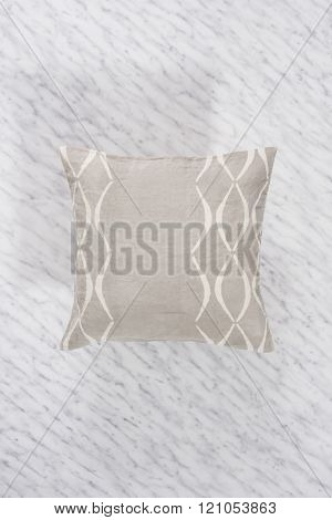 Square Gray Throw Pillow On Marbled Backdrop Casting Shadow