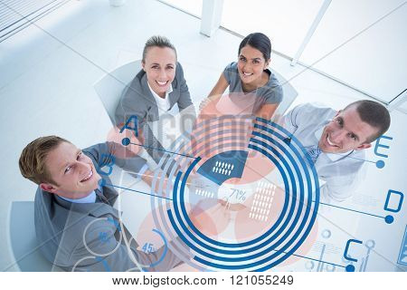 Graph against business team pointing clipboard