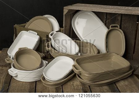 A Collection Of White And Tan-colored Earthenware