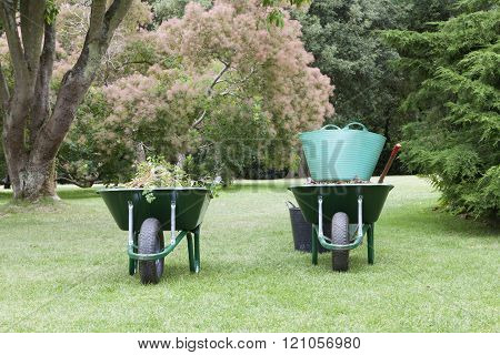 Landscaped garden with wheelbarrows and gardening tools