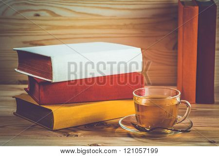 Cup Of Tea And Books Onwooden Background