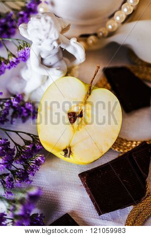 half an apple in a beautiful still life angel figurine