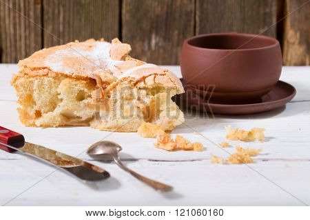 Piece Of Pie And Cup On A White Wooden Table
