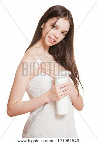 Young Brunette Using Body Lotion.