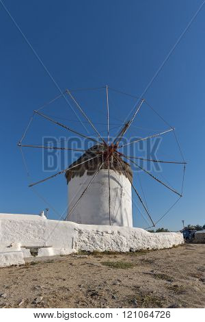 White windmill and medieval wall on the island of Mykonos, Greece