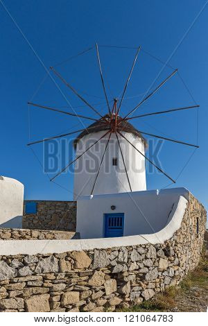 White windmill and Stone wall on the island of Mykonos, Greece
