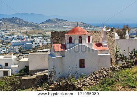 White church with red roof on Mykonos island, Greece
