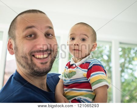Father and little cute son making grimaces