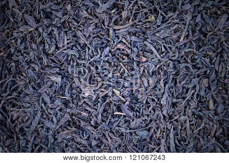 tea granules texture background close up