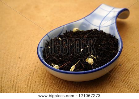 tea granules with a spoon