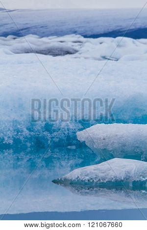 Abstract photo of luminous blue icebergs floating in Jokulsarlon glacial lagoon Iceland