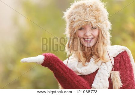 Smiling Woman In Fur Winter Hat With Copyspace.
