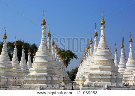 Large stupa forest of the Sandamuni Paya pagoda in Mandalay, Myanmar (Burma)