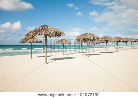 Umbrellas From Royal Palm Leaves, Parasole On Sandy Beach In Varadero On Cuba With Turquoise Caribbe