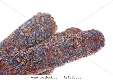 big french rye bread baguette topped with sunflower and poppy seeds isolated over white background