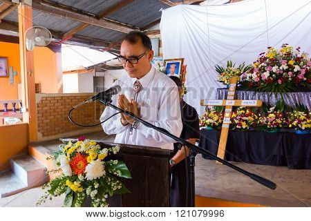 CHIANG RAI THAILAND - MARCH 2 : Unidentified pastor of a church praying for Christian funeral rites on March 2 2016 in Chiang rai Thailand.
