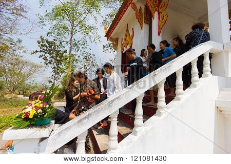 CHIANG RAI THAILAND - MARCH 2 : Unidentified people respecting dead person before cremation on March 2 2016 in Chiang rai Thailand.