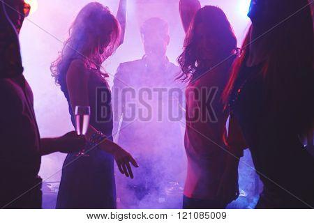 Group of dancing people in night club
