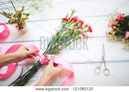 Close-up of florist making a bouquet
