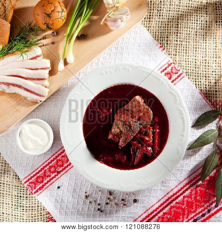 Beetroot and Cabbage Soup with Beef, Garnished with Bread, Lard and Sour Cream