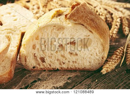 Cut Loaf Of Bread With Ears Of Wheat