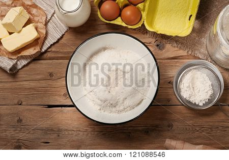 Flour in bowl with Ingredients for cooking bakery products