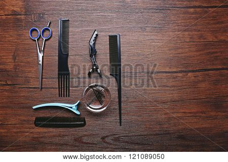 Barber set with tools on brown wooden table
